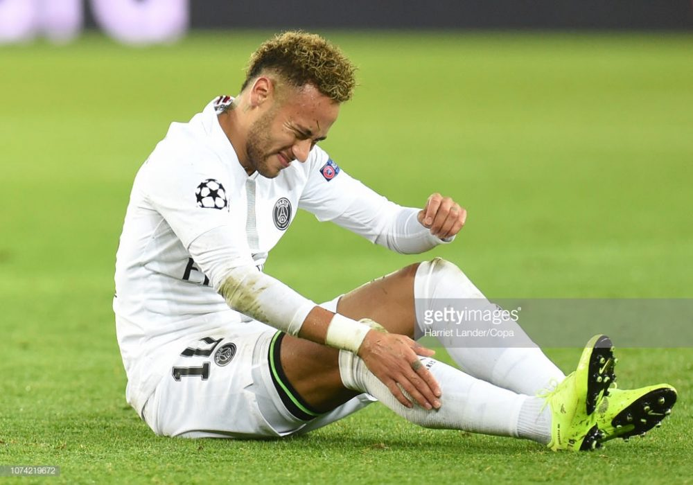 Neymar of Paris Saint-Germain goes down injured