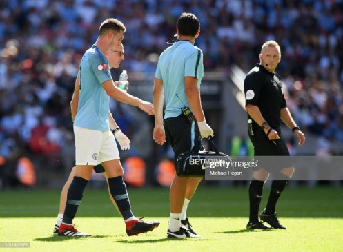 Aymeric Laporte of Manchester City leaves the field injured