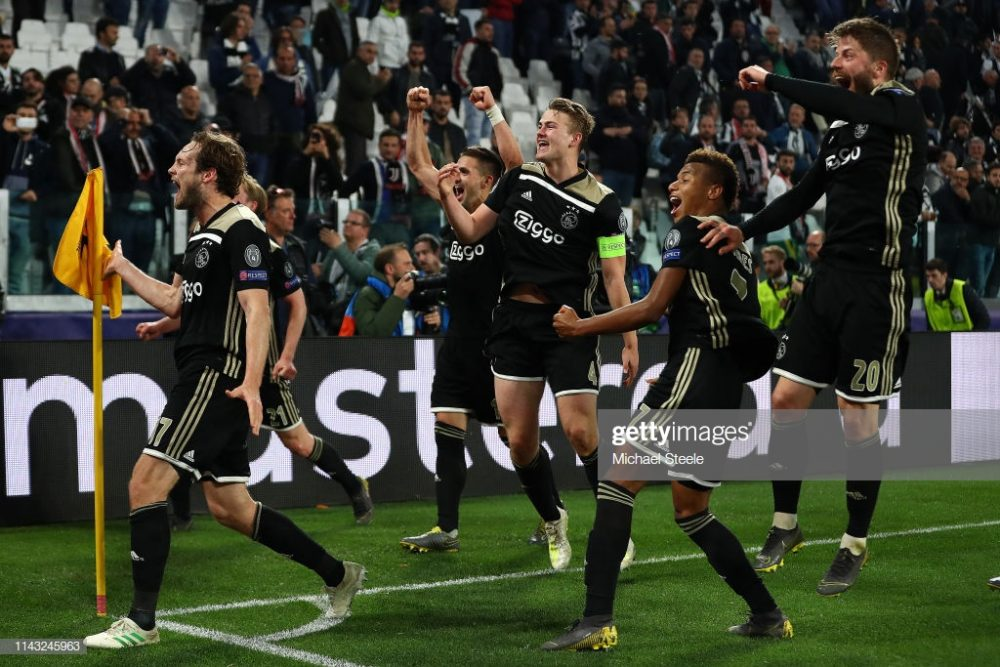 The Ajax players celebrate the second goal against Juventus