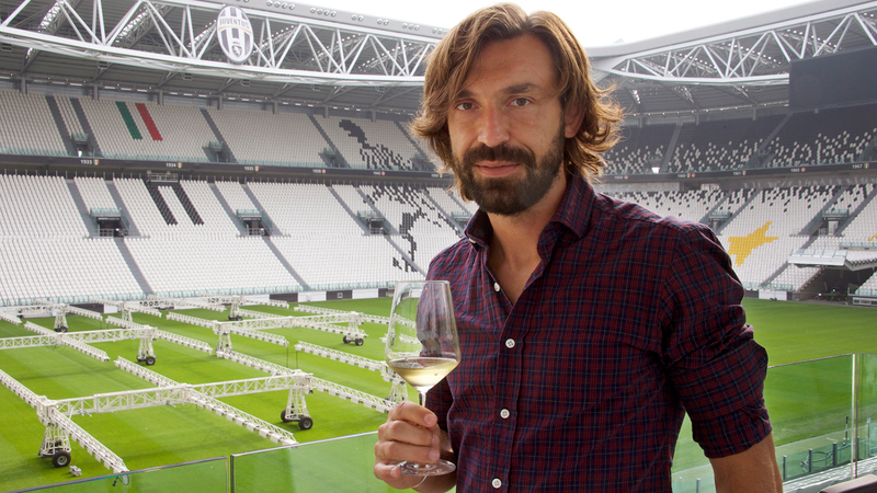 Andrea Pirlo drinks wine at the stadium