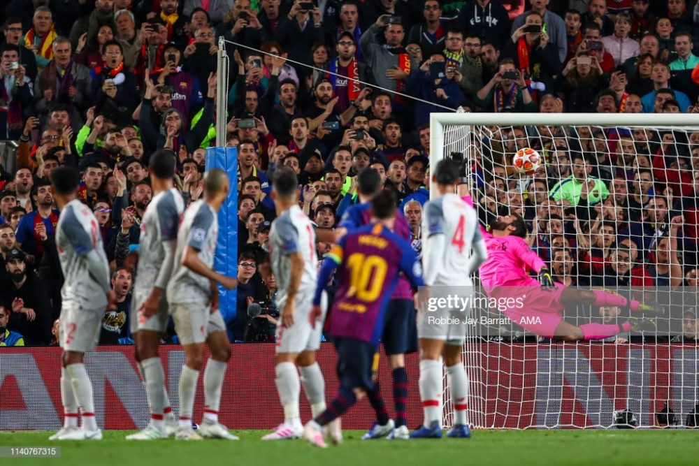 Lionel Messi of FC Barcelona scores a goal against Liverpool FC