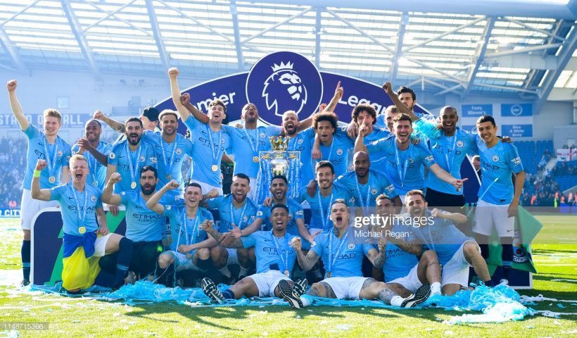 Manchester City pose with the Premier League trophy