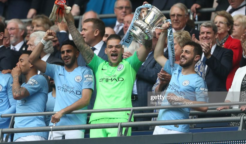Manchester City's Ederson and Bernardo Silva with the trophy during the FA Cup Final matchc