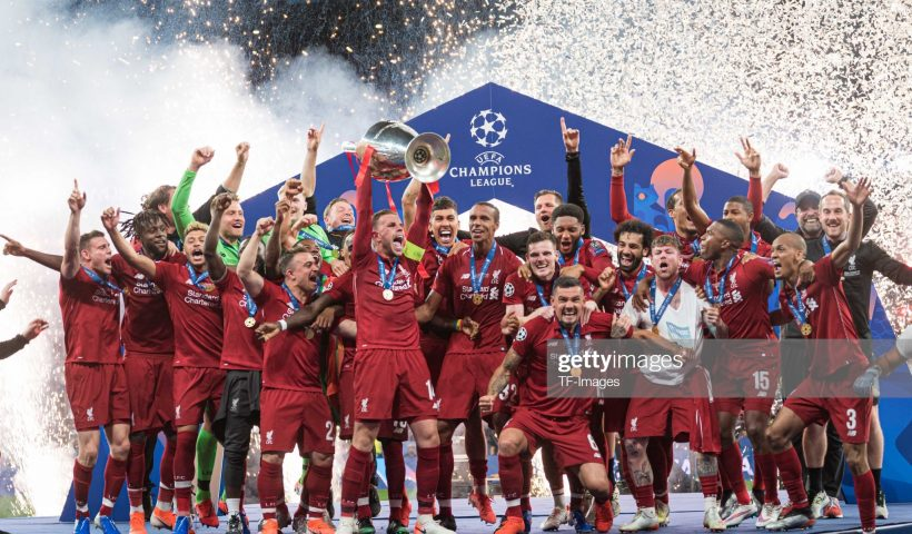 Players of FC Liverpool celebrate with the trophy after winning the UEFA Champions League