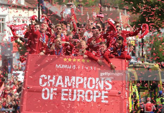 UEFA Champions League trophy on board a parade bus