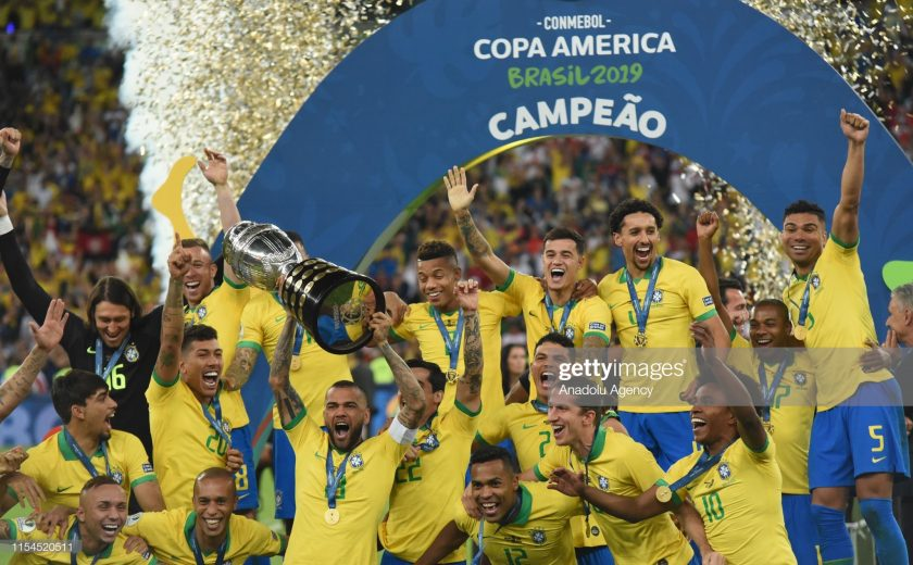 Brazil team celebrate with the trophy