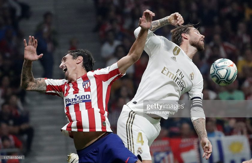 Sergio Ramos (R) of Real Madrid and Stefan Savic of Atletico Madrid