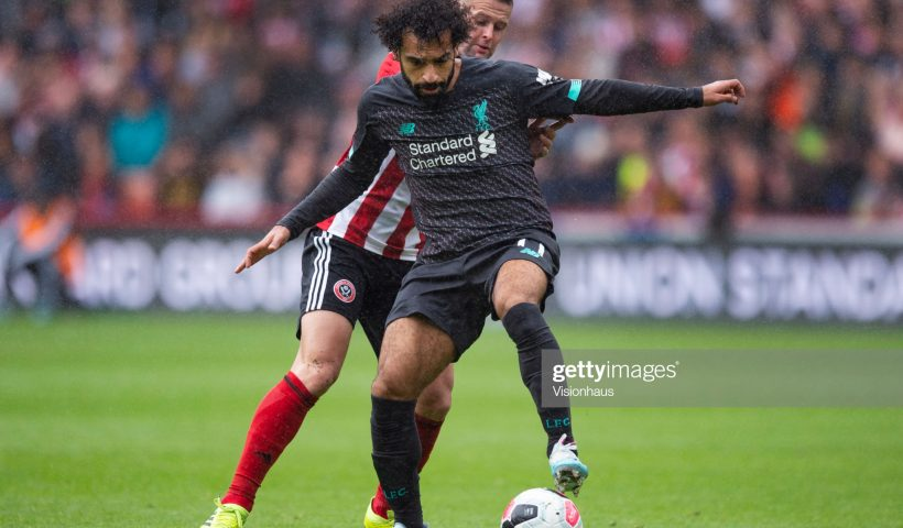 Mohamed Salah of Liverpool and John Fleck of Sheffield United