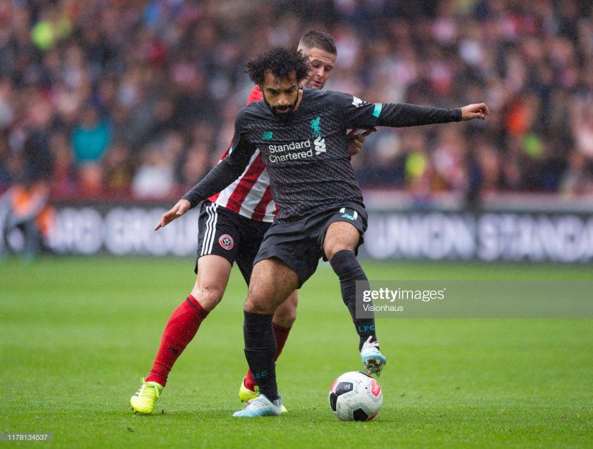 Mohamed Salah of Liverpool and John Fleck of Sheffield United