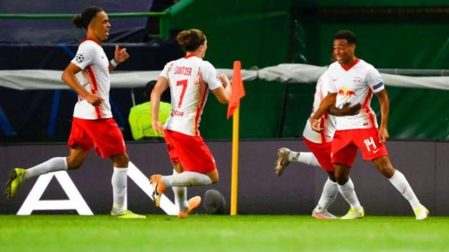 RB Leipzig players celebrate after victory against Atletico Madrid