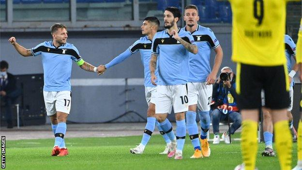 lazio players celebrate goal against dortmund