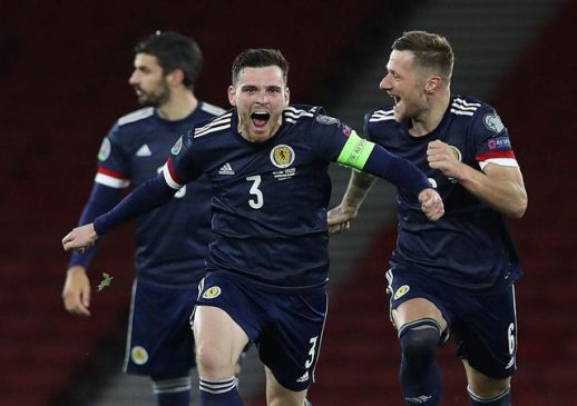 robertson and scotland celebrate victory against serbia